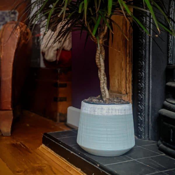 Lifestyle shot of Distressed Stoneware Planter