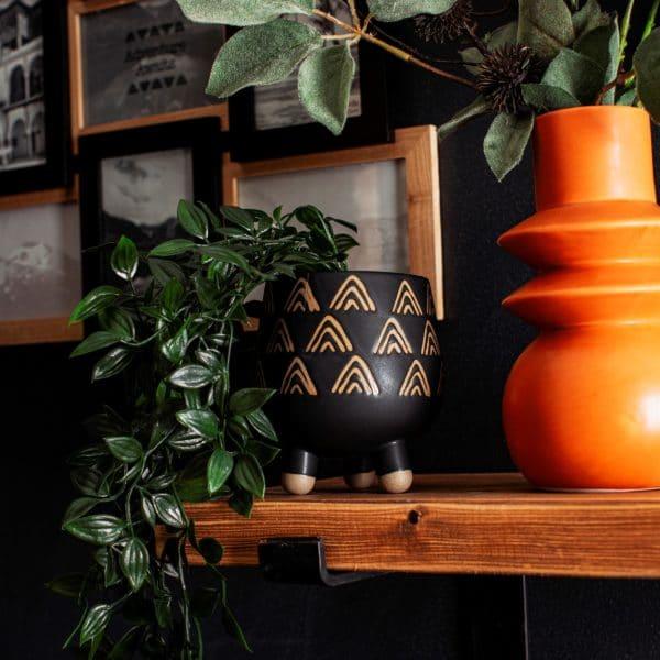 Black and bronze leggy planter lifestyle shot