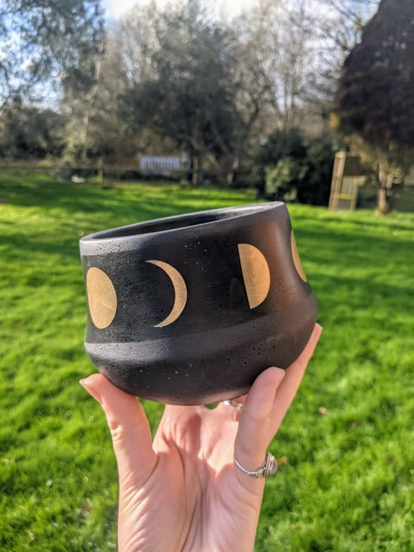 Black plant pot with moon phases print