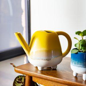 Yellow indoor watering can